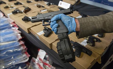 A handgun being held in a hand