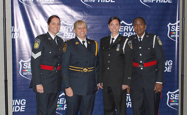 A group of four women in police uniform