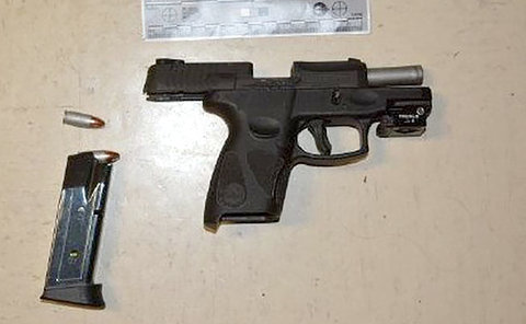 A black handgun on a table