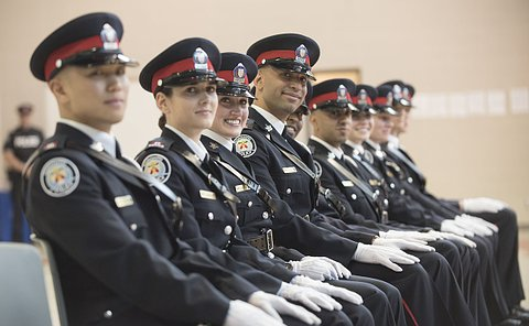 A row of TPS officers seated