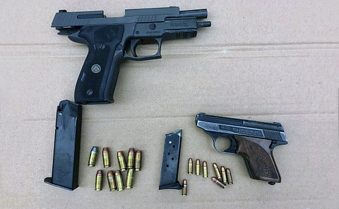 Two handguns, two magazines and several rounds of ammunition