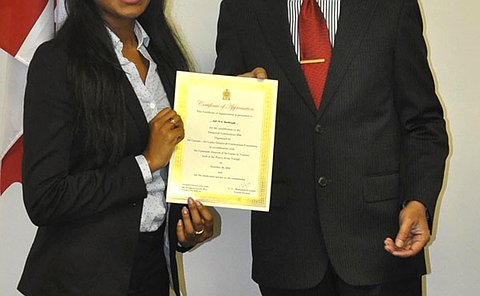 A woman and man hold a certificate