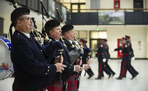 Pipers playing as people march by