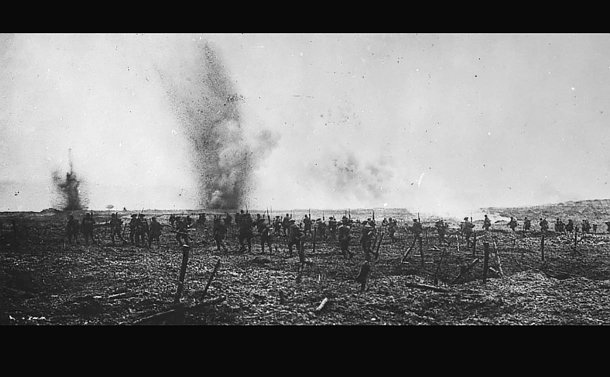 A line of soldiers with explosions in background