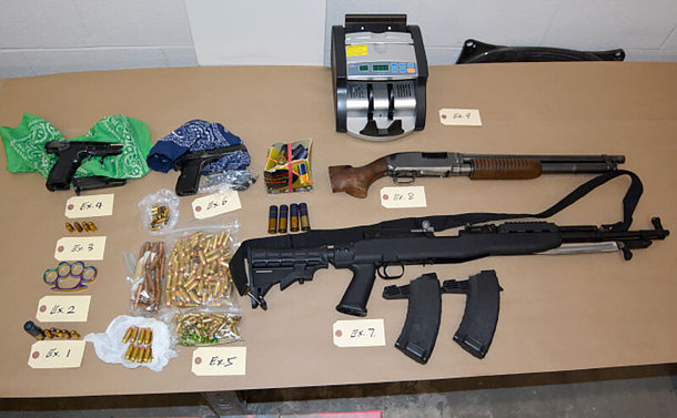 A table of guns and ammunition