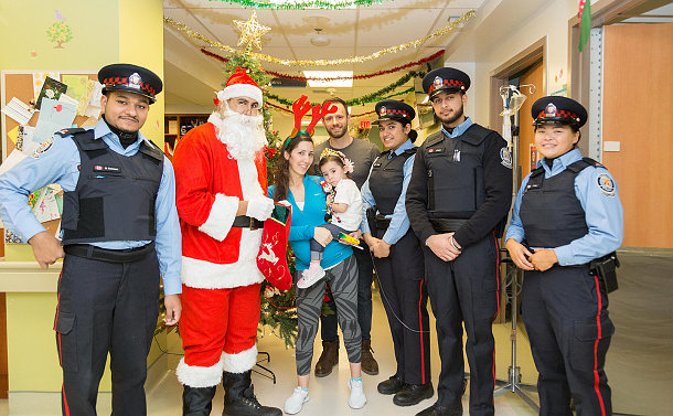 A group people in TPS Auxiliary uniform with a man dressed as Santa and others