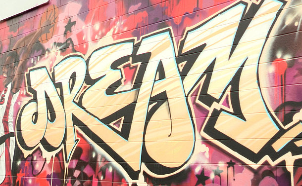 A mural with stylized writing the word: dream