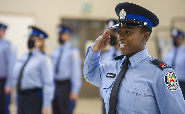 A woman in TPS special constable uniform saluting