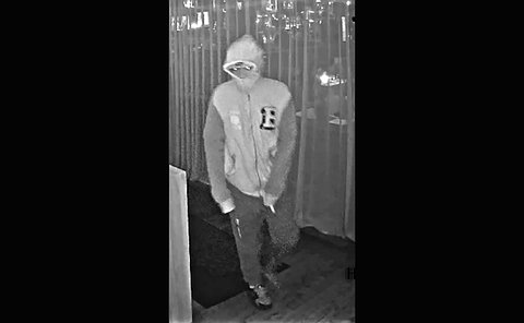 Security image of a person in hooded sweater