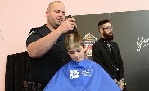 Man shaving a boy's head