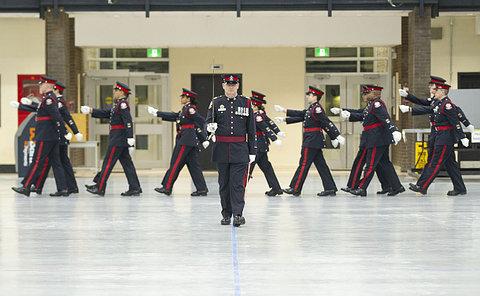 A man in TPS uniform carrying a sword