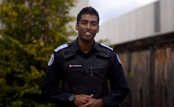 A man in TPS cadet uniform smiling