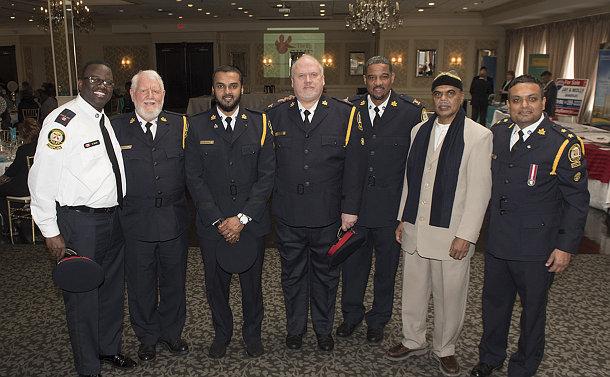A group of men in TPS chaplain uniform