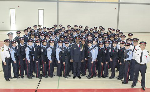 A large group standing together in various TPS police and Auxiliary uniforms