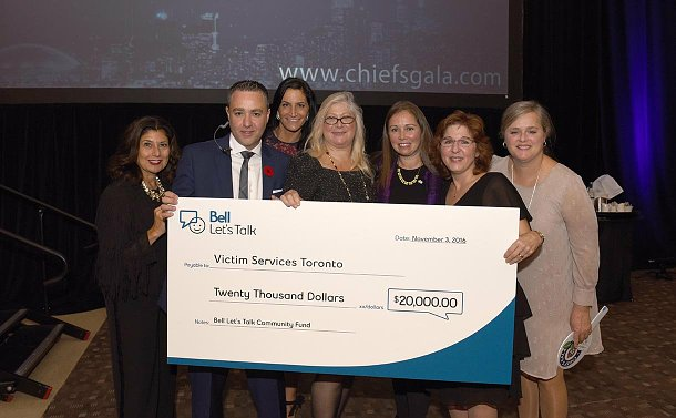 A group of people with an oversized cheque