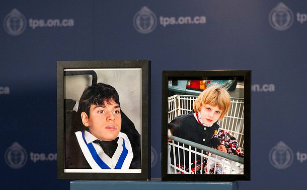 Two framed photos on a podium