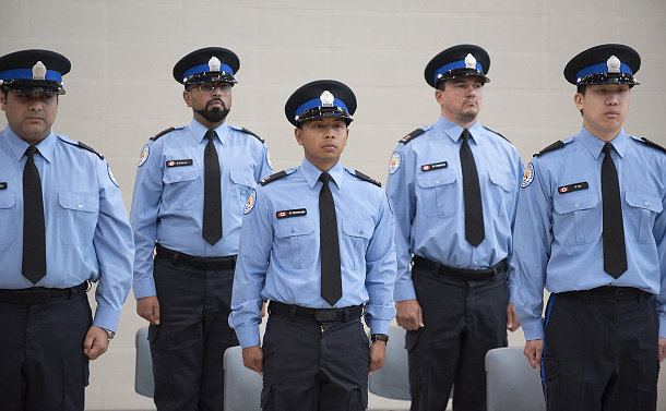 A group of men in TPS parking uniforms