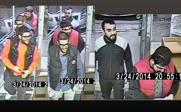 Several surveillance video images of four men walking through a door