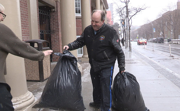 A man holding garbage bags