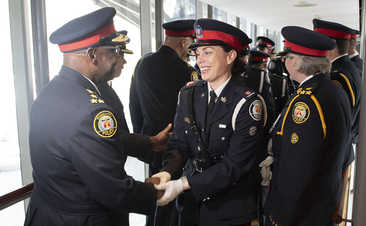 A group  of people in TPS uniform shaking hands