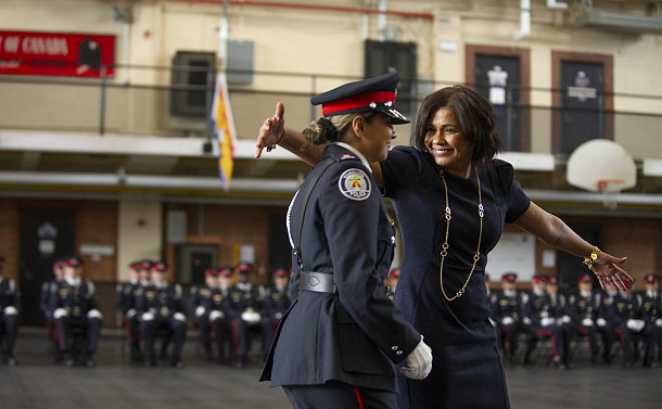 A woman greeting a woman in TPS uniform