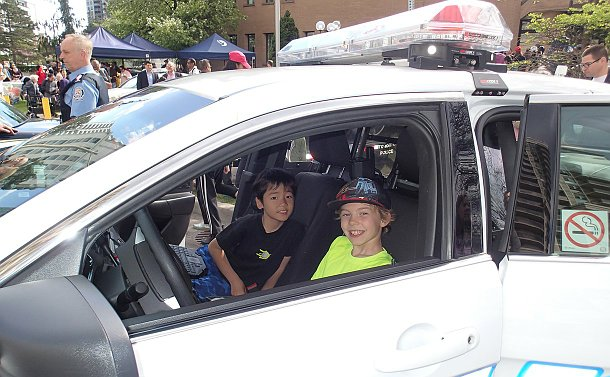 Two boys in a police car