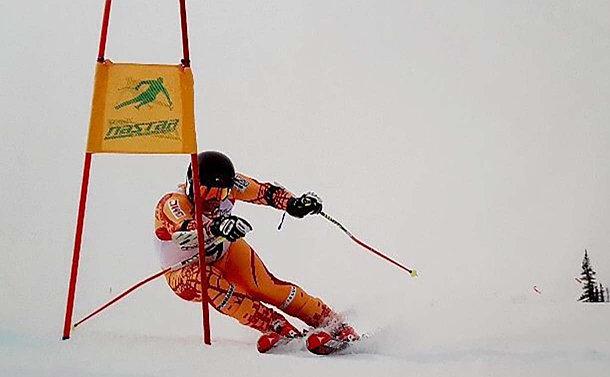A ski racer turns around a gate