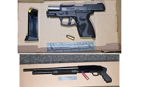 A black handgun and shotgun on a table