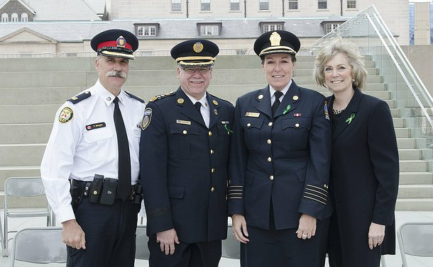 One man in TPS uniform, one man in Paramedic uniform beside a woman in Fire uniform and another woman