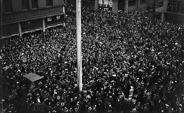A large group of people fill a street