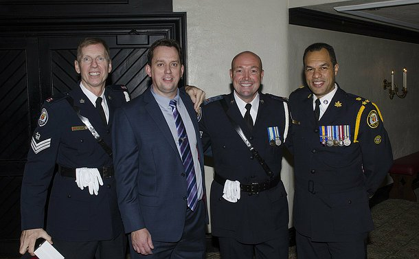 Four men, three in TPS uniform standing together