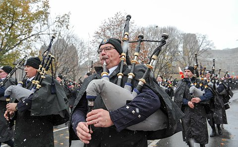 Men in TPS uniform playing bagpipes