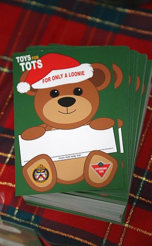 A stack of cards with a bear as well as TPS and Canadian Tire logos