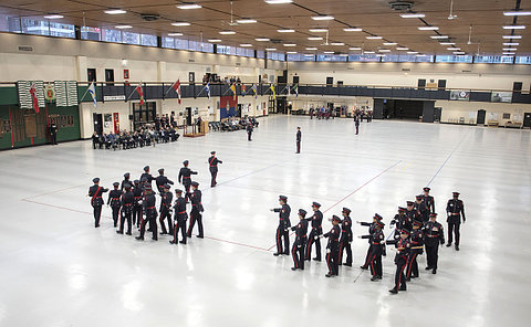 A group of people in TPS uniform in a large gym like setting