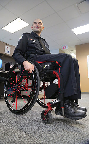 A man in TPS uniform in a wheelchair