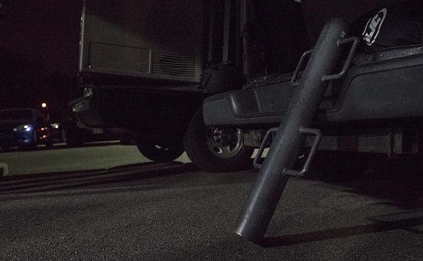 A battering ram against a truck bumper