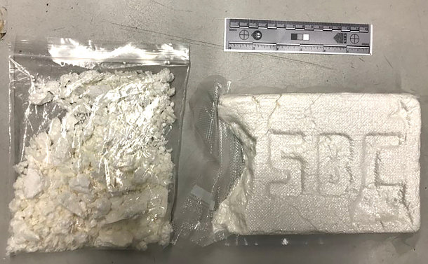 Two plastic bags of white substance