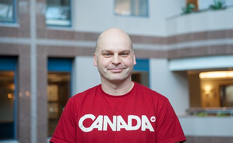 A man wearing a red Canada t-shirt