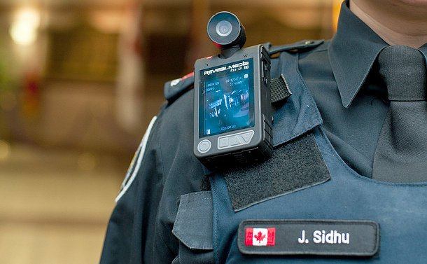 Close up of a camera and display on the chest of a TPS uniform
