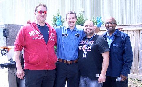 Four men standing together