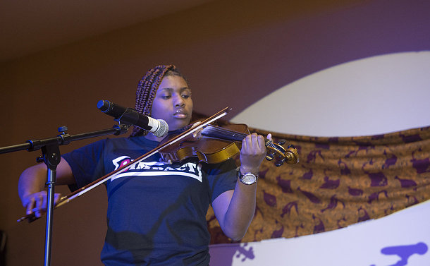 A girl playing a violin