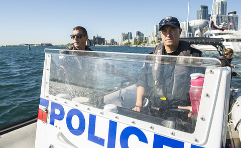 Two men in a boat in TPS uniform