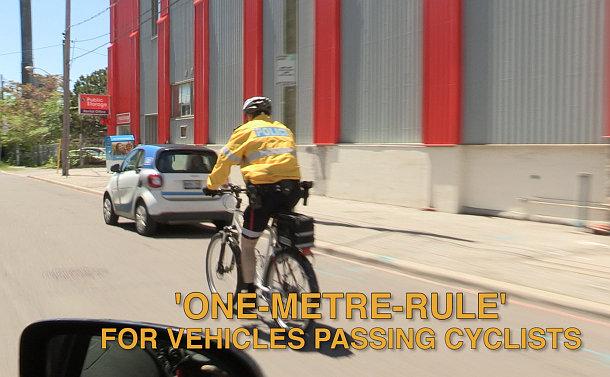 A man in TPS uniform cycling