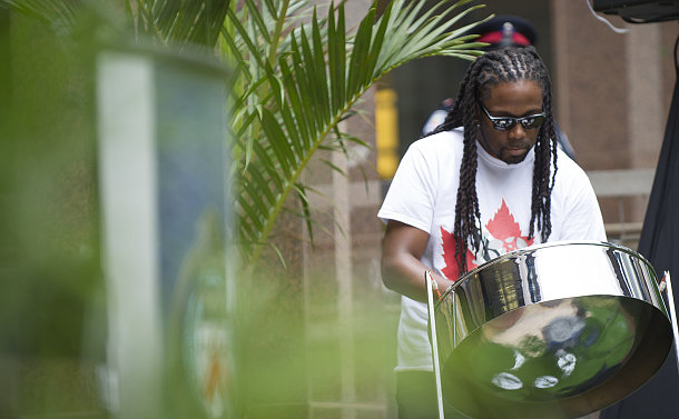 A man plays a steel drum