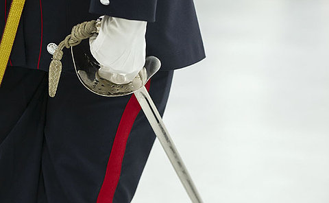 A close up of a sword in a hand