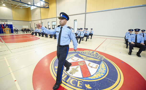 A man in TPS special constable uniform marching