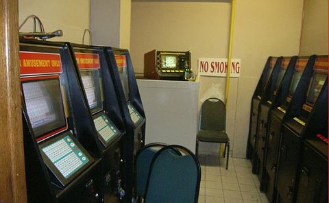 A room of machines with screens and the words amusement only written on them