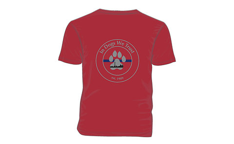 A crest with a paw print on a t-shirt with words: in dogs we trust