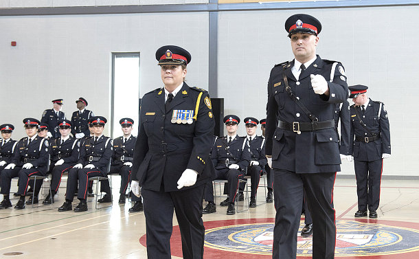 A man and woman walking in TPS uniform