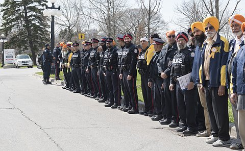 Toronto Police Officers line up as the Chief enters.